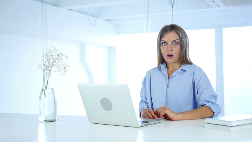 Young Woman Gesturing Shock at Work, Astonished | Shutterstock HD Video #30969310