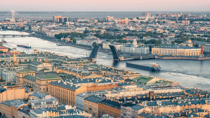 Cargo ship passes by the Trinity bridge and Neva River at night in St.Petersburg, Russia. | Shutterstock HD Video #30990778