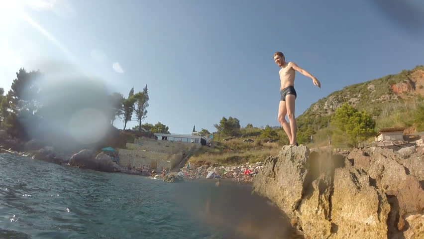 Athletic Young Man Jumping From Cliff Into Ocean Sea Water Muscular Adventure Extreme Sports Lifestyle Hobby Vacation Clear Beach Slow Motion Leisure Activity Gopro | Shutterstock HD Video #31007920