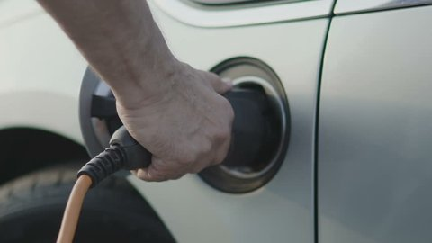 Charging of electric car. Slow motion 100 fps