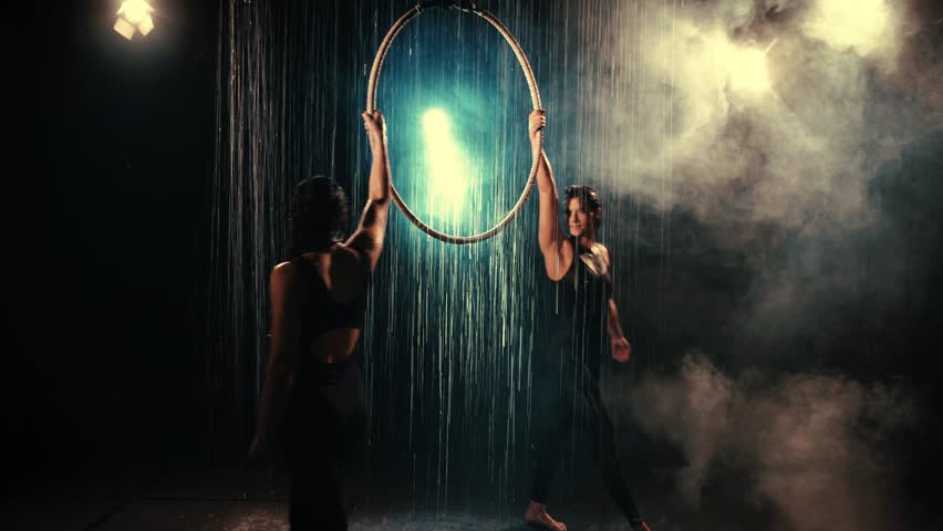 Young sports women dancing with ring. With water and smoke effect. 4K.  | Shutterstock HD Video #31018447