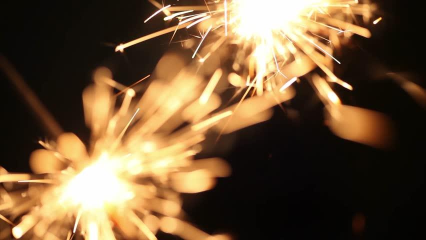 Close up burning of Christmas sparklers. Fireworks lit on black background | Shutterstock HD Video #31021678