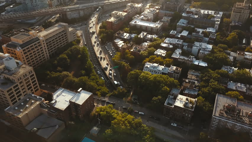 Aerial view of the Brooklyn district in New York, America, Drone flying over the apartments and traffic road on sunset. | Shutterstock HD Video #31039336