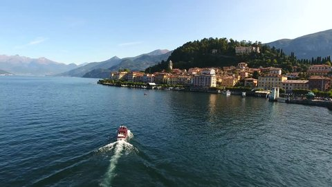 Village of Bellagio and boat on Como lake in Italy