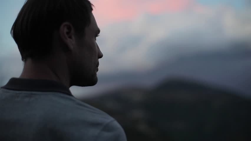 Man on mountain top looks down determined to conquer the world close up slow motion. Male head silhouette back side view at evening sky background enjoying view of success. Self-made person concept | Shutterstock HD Video #31079338