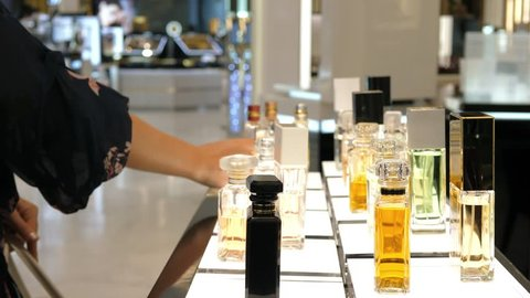 Woman Hand Choosing Luxury Parfume In Perfume Shop. Closeup. 4K.