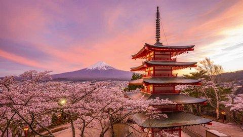 Fujiyoshida, Japan at Chureito Pagoda and Mt. Fuji in the spring with cherry blossoms.