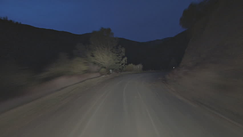 Timelapse fast driving POV shot, Mendocino National Forest, Bartlett Springs Road, dirt, at night.