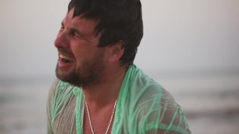 Crying screaming man. Depressed lost man screaming. Drama concept. Desert island.