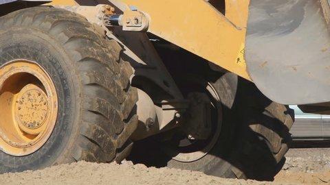 Closeup loader excavator at road construction work