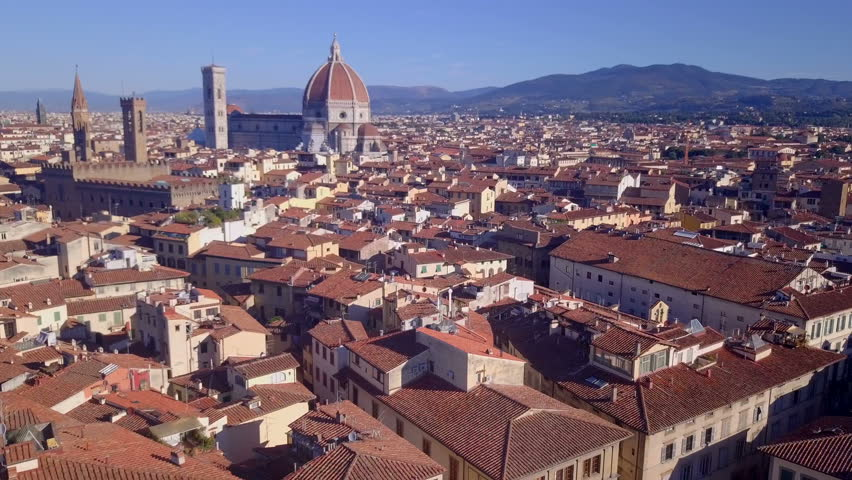 AERIAL: drone flying over the Florence city, Italy. Old, historical city in Toscana. Beautiful sityscape, old roofs.