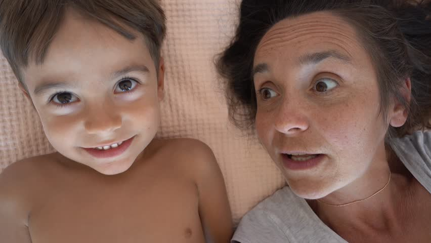 4K Selfie mother scolds her son and he pulls her nose, continuation of 4 years selfies  | Shutterstock HD Video #31217668