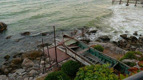 Old wooden boat on a stony shore in Sozopol, Bulgaria.