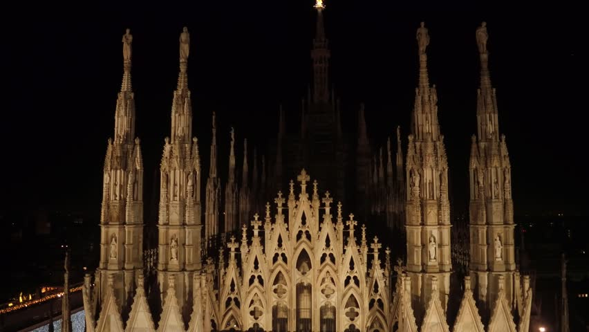 Aerial drone footage view of cathedral dome in Milan italy by night // no video editing