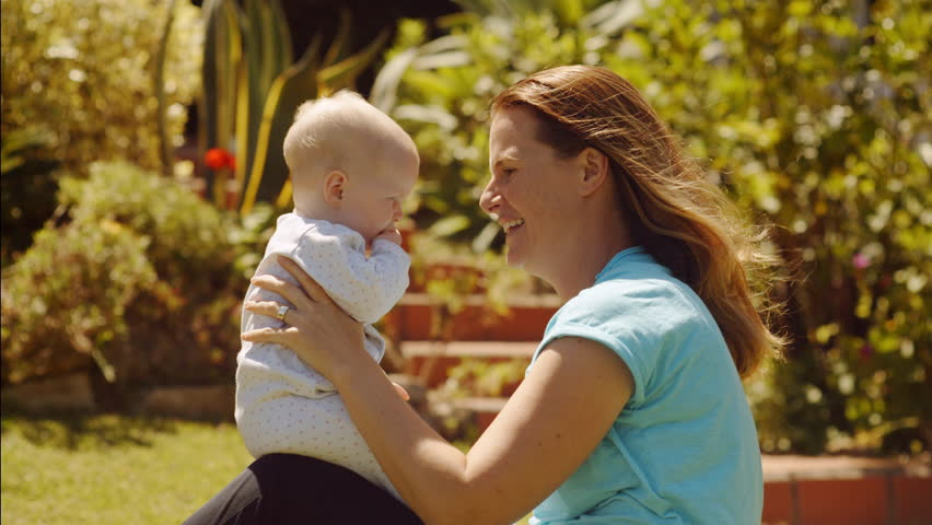 Mother and baby daughter in garden playing together | Shutterstock HD Video #31262128