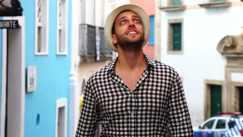 Young traveler walking and looking forward at Pelourinho, Salvador, Brazil | Shutterstock HD Video #31264378