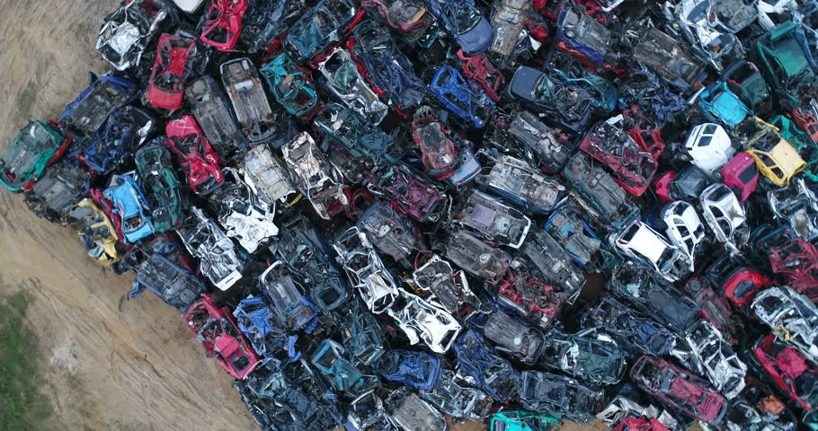 Old cars stacked in scrapyard. Car recycling