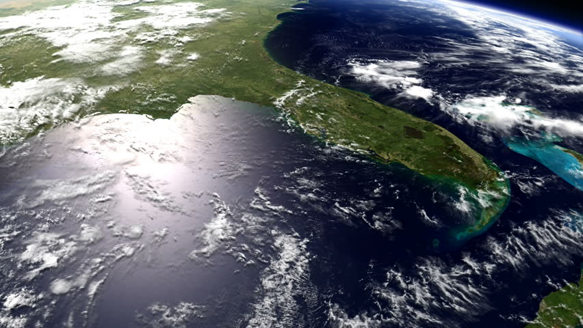 View of Florida from Space, including much of the Gulf of Mexico, seen from a low orbit of earth with a light scattering of clouds.