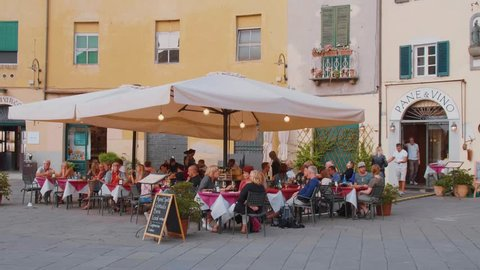 Restaurant at Amphitheater Square in Lucca - LUCCA / ITALY - SEPTEMBER 13, 2017