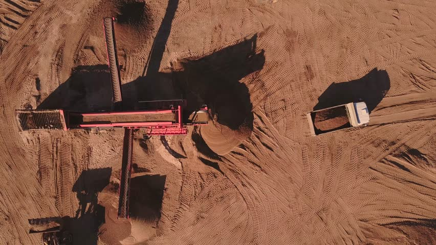 Aerial view of loading sand into trucks