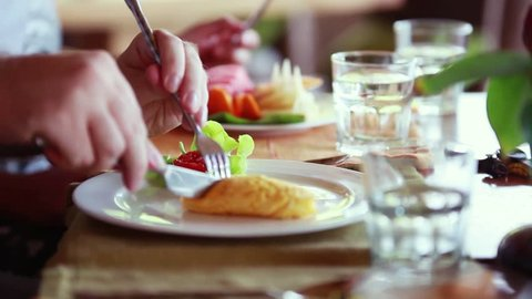 Happy family having breakfast omelet with fruit salad and glass of the water, 1920x1080
