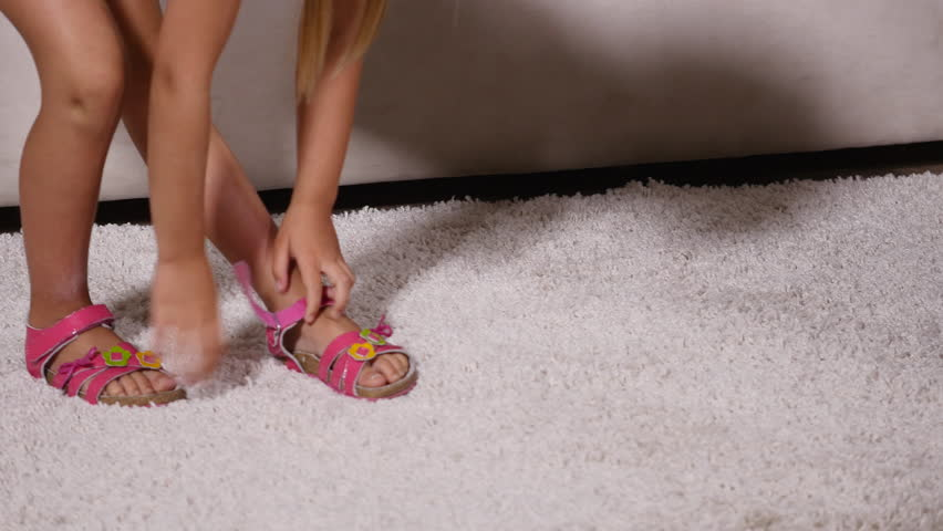 58ba0d88e8d7 Girl Takes Off Pink Sandals Stock Footage Video (100% Royalty-free ...