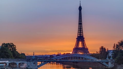 Eiffel Tower sunrise timelapse with boats on Seine river and in Paris, France. View from Grenelle bridge.