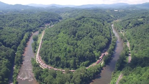 Aerial approach of a River Bend in the Appalachian Mountains, Blue Ridge Mountains during the Springtime season over the Appalachian River.