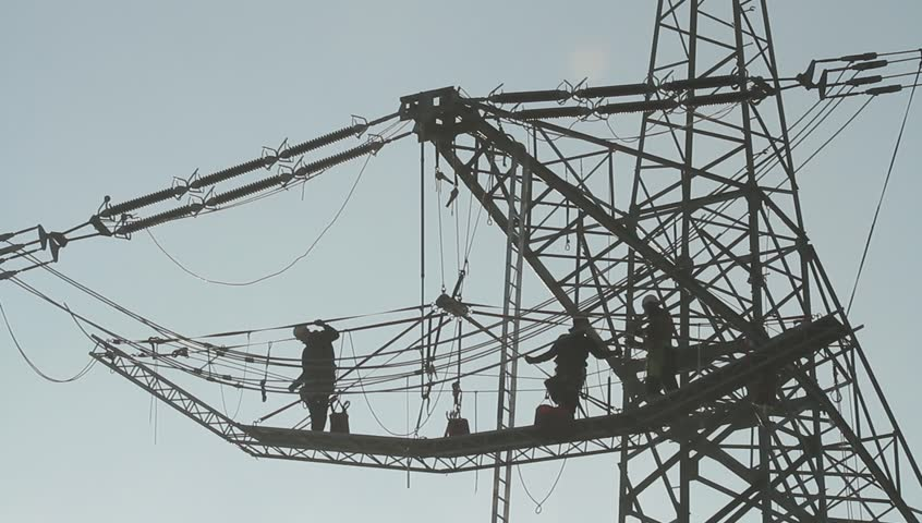 Men working on transmission line silhouettes