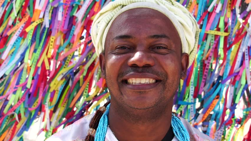 Candomble priest wearing traditional clothes at Bonfim Church in Salvador, Bahia, Brazil