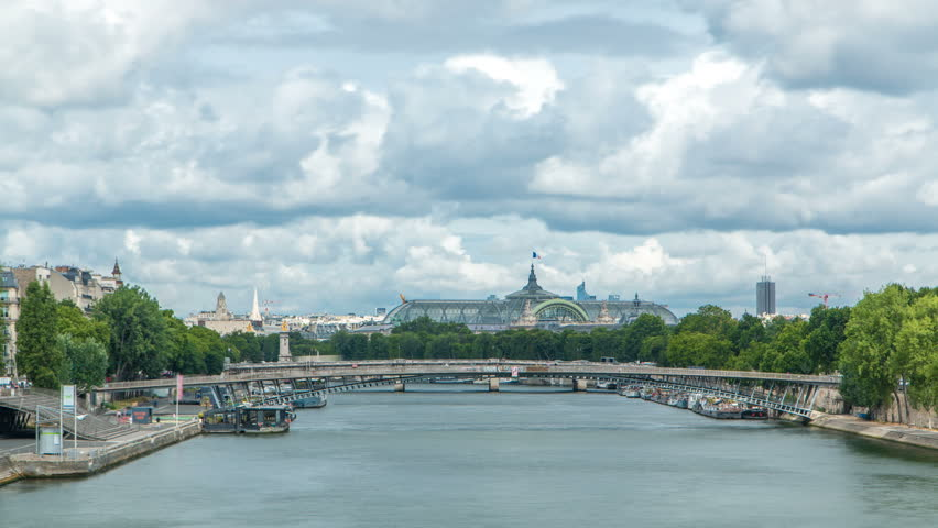 View of the Grand Palais exhibition hall and boats on the Seine River as seen from Royal bridge timelapse. Footbridge Leopold Sedar Senghor. Cloudy sky at summer day | Shutterstock HD Video #31364488