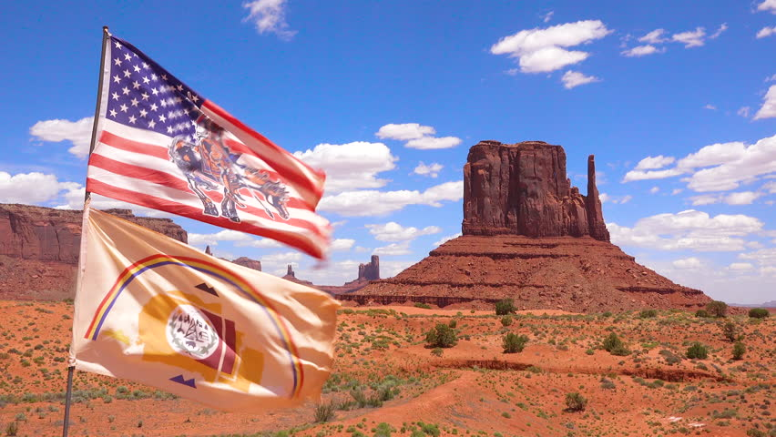 CIRCA 2010s - Monument Valley, Utah - The Navajo Nation flag flies in Monument Valley Tribal Park.