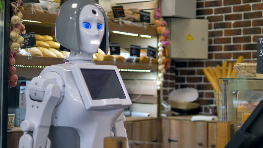 A white robot works at a bakery counter.    Shutterstock HD Video #31375276