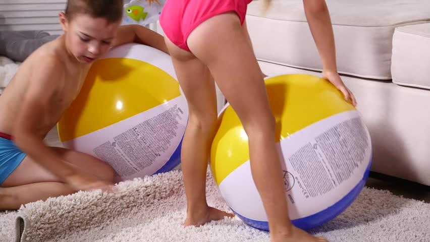 naked girls on inflatable ball