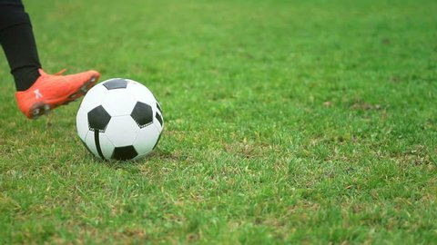 Close-up of young soccer player taking a penalty kick