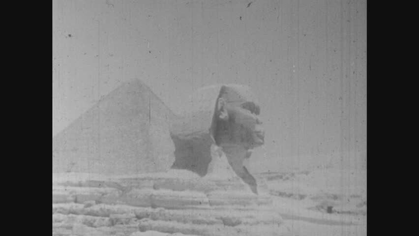 1950s: UNITED STATES: Egyptian pyramid. Great sphinx carved in stone in Egypt. Map of world.