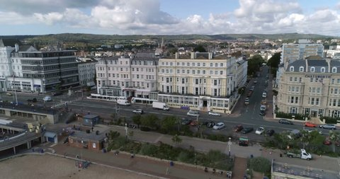 Aerial panning view of the seafront of the town of Eastbourne, Southern England