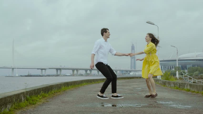 Couple dancing rock-n-roll dance together at the embankment after the rain. | Shutterstock HD Video #31429792