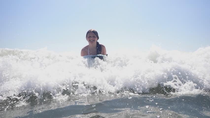 Girl Bodyboarding In Ocean Waves At Myrtle Beach SC Vacation