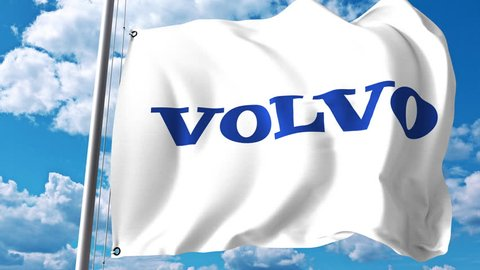 Waving flag with Volvo Group logo against clouds and sky. 4K editorial animation