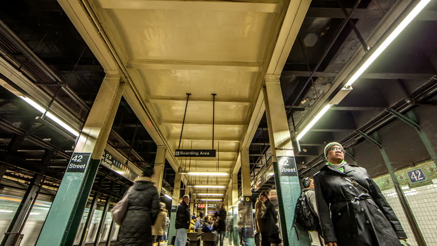 NEW YORK - CIRCA JULY 2012: timelapse of MTA 42nd street subway station platform with people waiting for train in Manhattan, New York City, NYC, USA