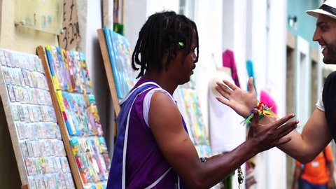 Brazilian Street Vendor selling his products for the Tourist in Salvador, Bahia, Brazil