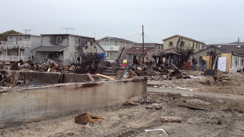 BREEZY POINT, QUEENS, NY-December 2, 2012: Video clip of wreckage and debris from homes destroyed by devastating fire during Hurricane Sandy.  End of clip reveals people carrying recoverable items.