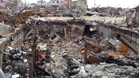 BREEZY POINT, QUEENS, NY-December 2, 2012: Video clip of wreckage and debris from homes destroyed by devastating fire during Hurricane Sandy. End of clip tilts up to reveal wreckage and reveals homes.