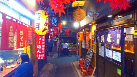 Tokyo, Japan - September 19, 2017 :Omoide-Yokocho in Shinjuku Tokyo at night.Both sides of alley are lined with izakaya bars and restaurants.