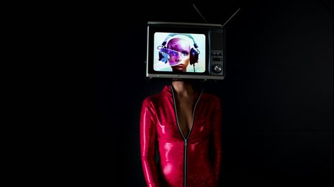 woman dancing and posing with a television as a head. the tv is has a video of a mannequin head from my own collection on it