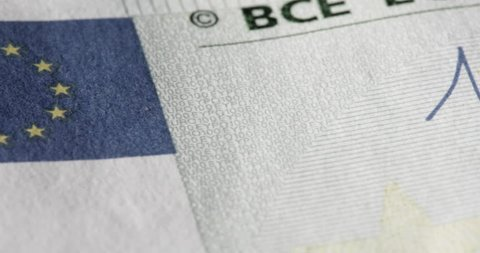 Macro of banknote Euro. Fifty, twenty and one hundred. The signature and the various symbols and details with watermark.