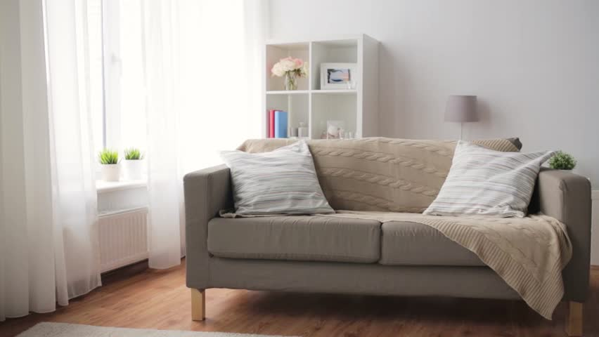 Comfort Furniture And Interior Concept Sofa With Cushions At