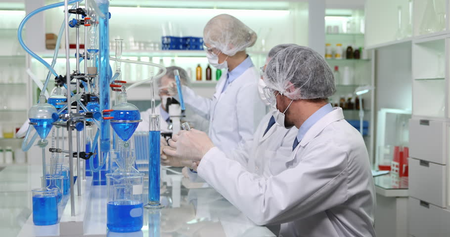 team of researchers conversation on various scientific experiments in laboratory 4k stock footage clip