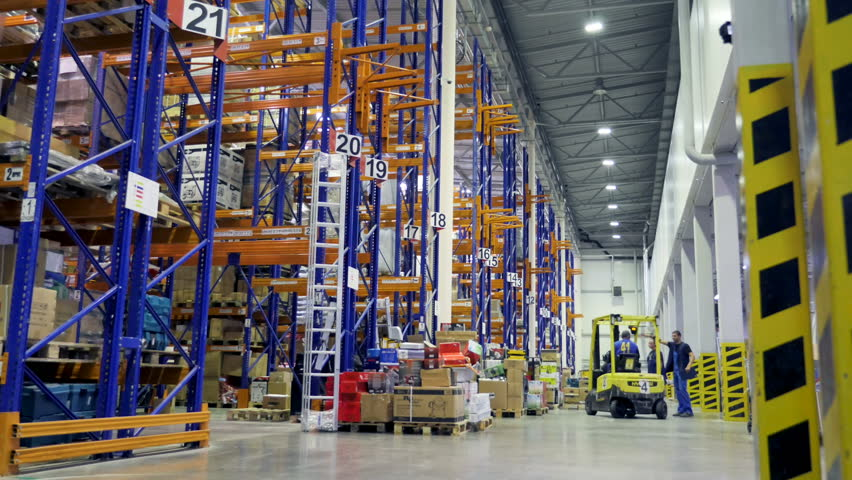 Timelapse of a large warehouse during work.